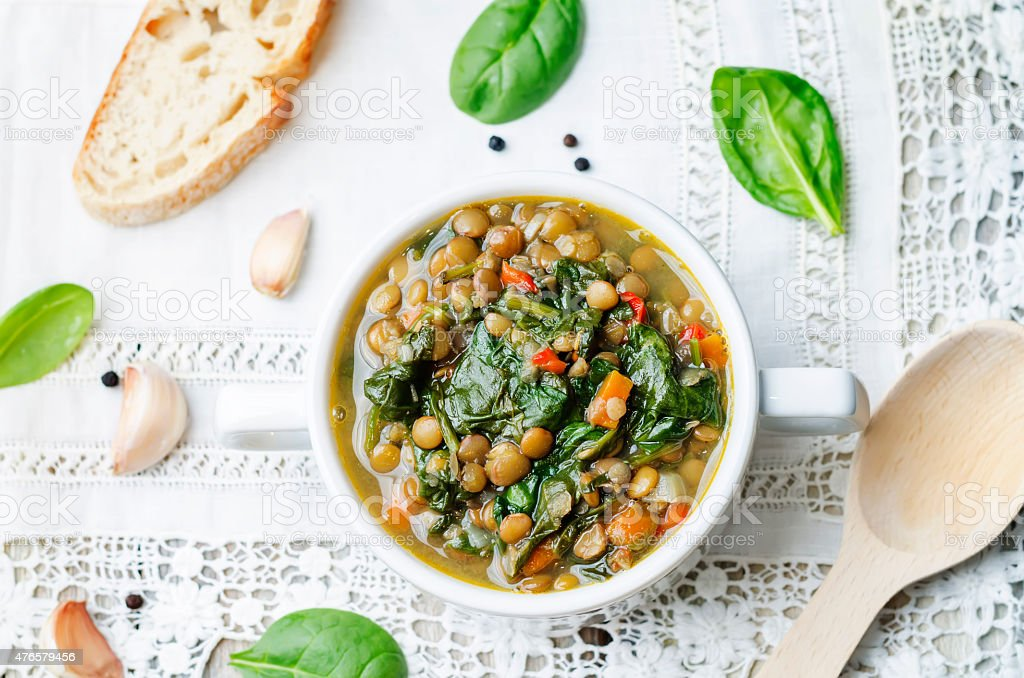 Lentil spinach soup stock photo