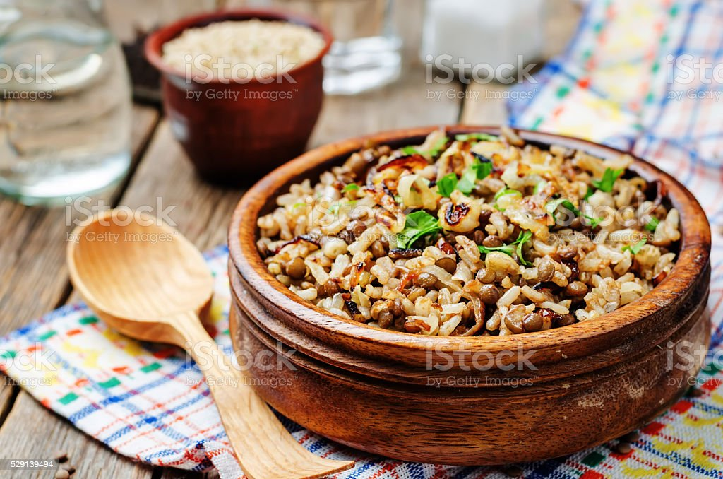 Lentils and rice with Crispy Onions and Parsley stock photo