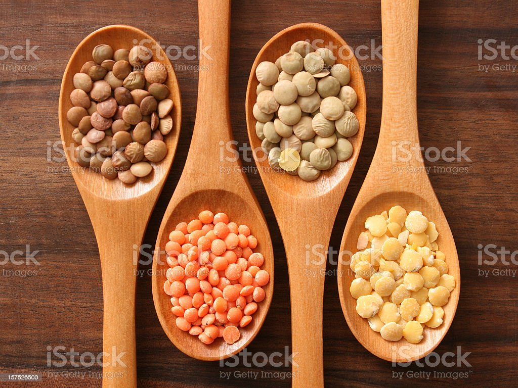 Lentils and spoons stock photo