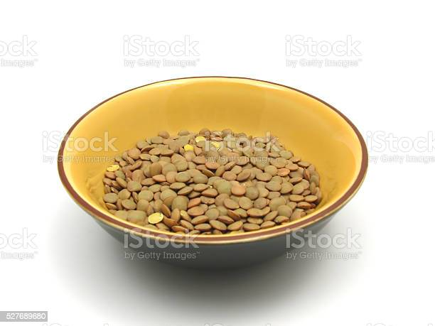 lentils  in a bowl of ceramic on white background
