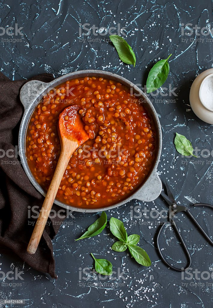 Lentils in tomato sauce in the pan. Vegetarian lentil bolognese stock photo