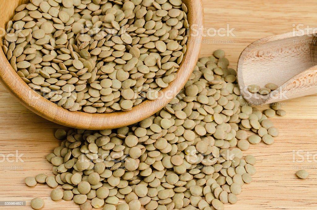 lentils, on wood, background, close up stock photo
