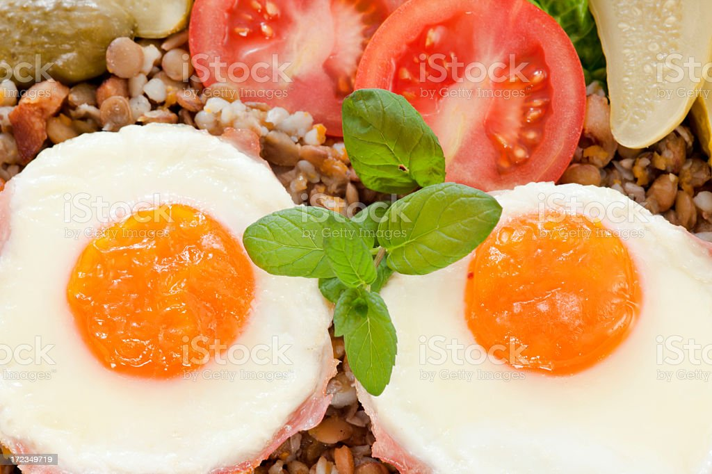 Lentils with  Buckwheat  and fried eggs royalty-free stock photo