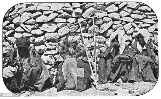 People suffering from leprosy in Jerusalem, Israel. Vintage halftone photo etching circa late 19th century.