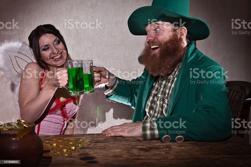 Leprechaun and fairy drink green beer royalty-free stock photo