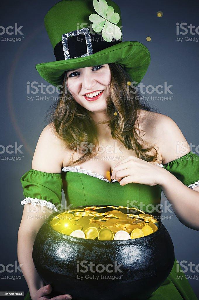 leprechaun gold hiding between her breasts stock photo