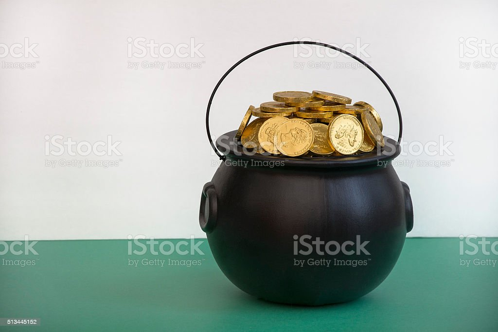 leprechaun gold in black pot stock photo