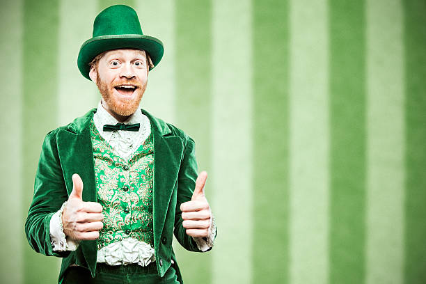 leprechaun man celebrating - st patricks day stock photos and pictures