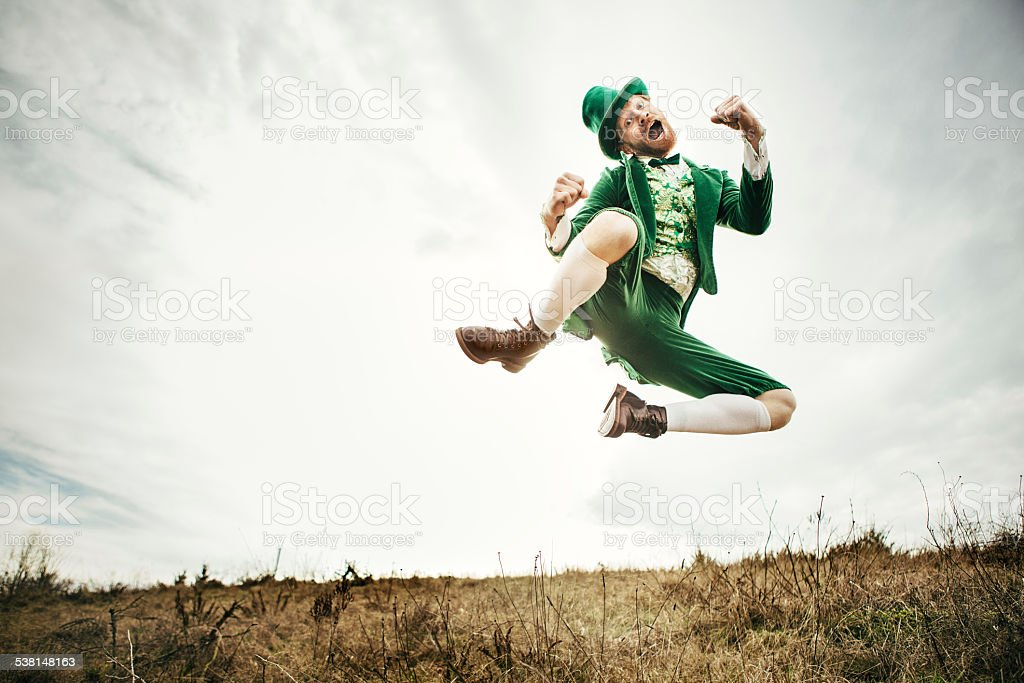 Leprechaun Man Dancing on St. Patricks Day stock photo