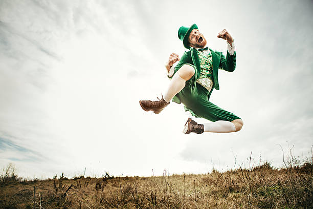 leprechaun man dancing on st. patricks day - st patricks day stock photos and pictures