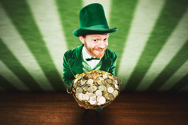 leprechaun man with pot of gold - happy st. patricks day stock photos and pictures