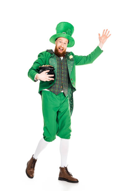 leprechaun waving and holding pot of gold, isolated on white - happy st. patricks day stock photos and pictures