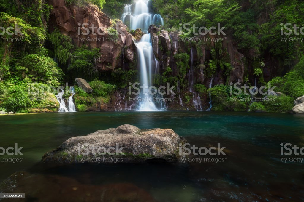 Les Cormorans waterfall in Saint-Gilles on Reunion Island royalty-free stock photo