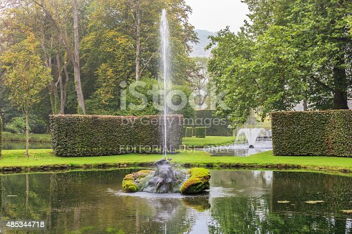 Annevoie, Belgium - September 6, 2014: Les Jardins d'Annevoie are a vast park that contains gardens of French, English and Italian style, with tree-lined paths, dozens of waterfalls and fountains, pools and ponds. It is the park of the castle of the same name, dating back to the eighteenth century, well known just to the beauty of its huge gardens. Annevoie is located in the provincie of Namur, in the Walloon region.
