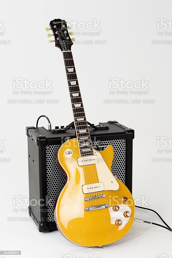 56 les paul pro electric guitar with roland cube amp stock photo download image now istock. Black Bedroom Furniture Sets. Home Design Ideas