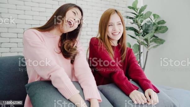Lesbian asian couple sing a song and dancing in living room at home picture id1159042060?b=1&k=6&m=1159042060&s=612x612&h=rl2abmk1kajrnw80lecoawmgiguu9ykohqnc 2tjhiy=