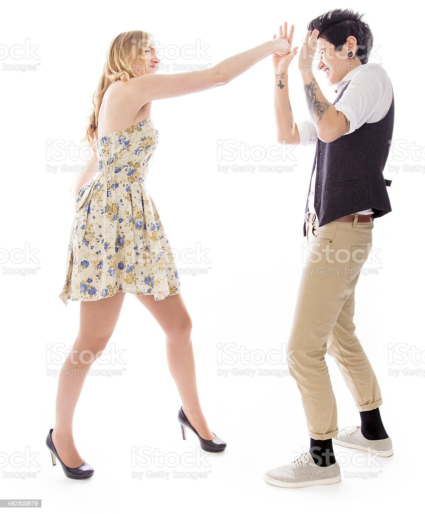 Lesbian couple fighting to each other stock photo