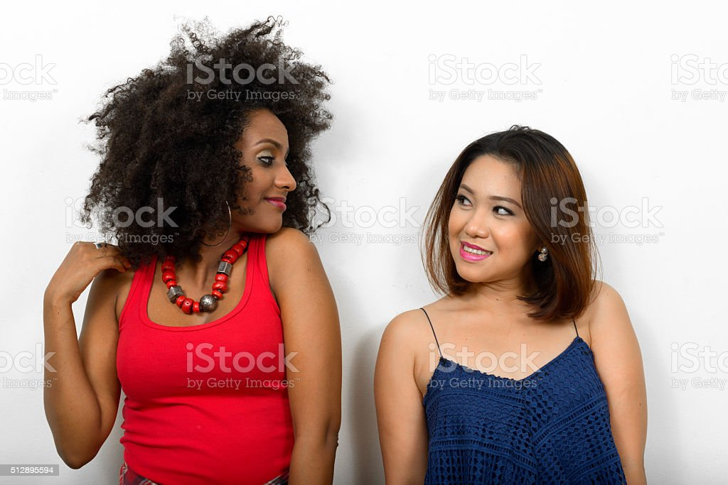 Lesbian couple looking each other stock photo