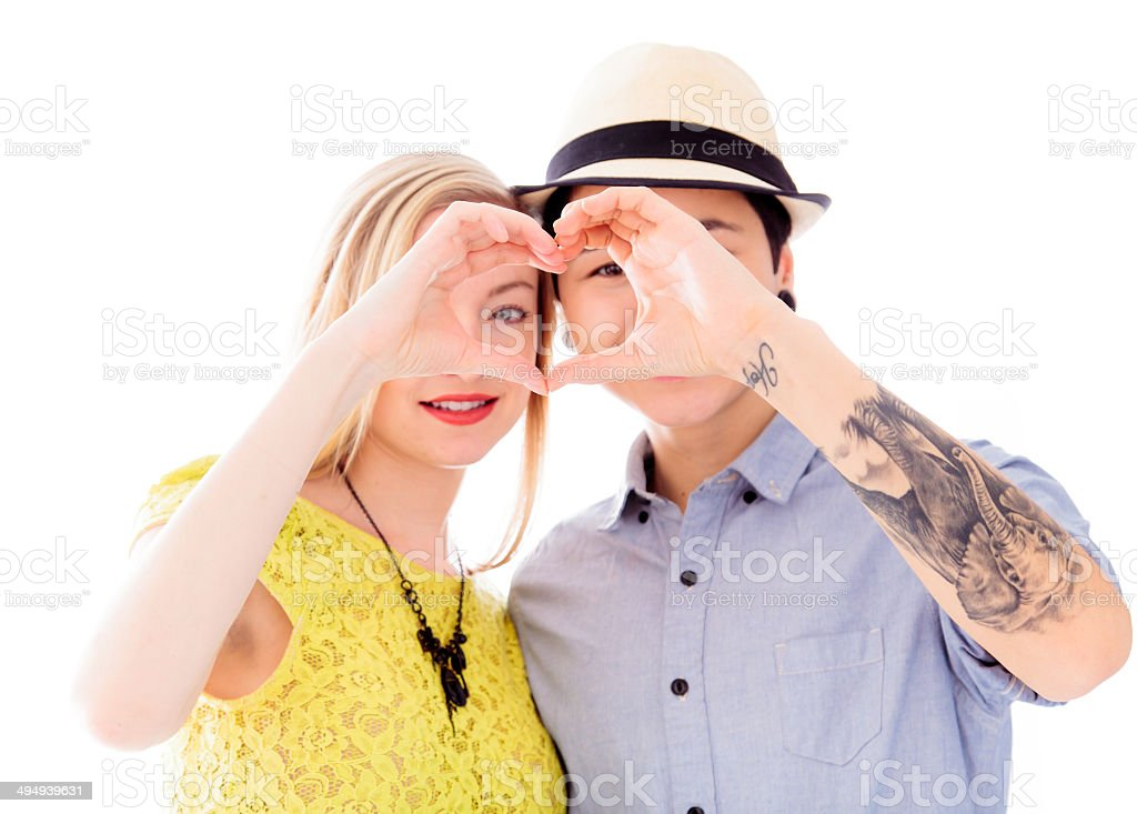 Lesbian couple making heart shape with hands stock photo