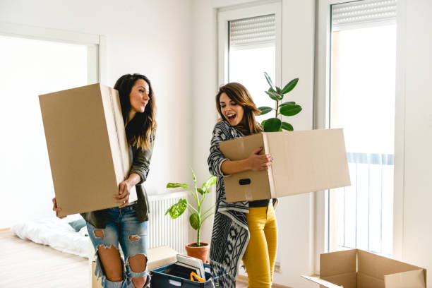 Lesbian couple moving into a new apartment stock photo