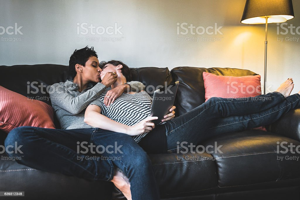 Lesbian Couple Share Cuddling On The Couch Stock Photo ...