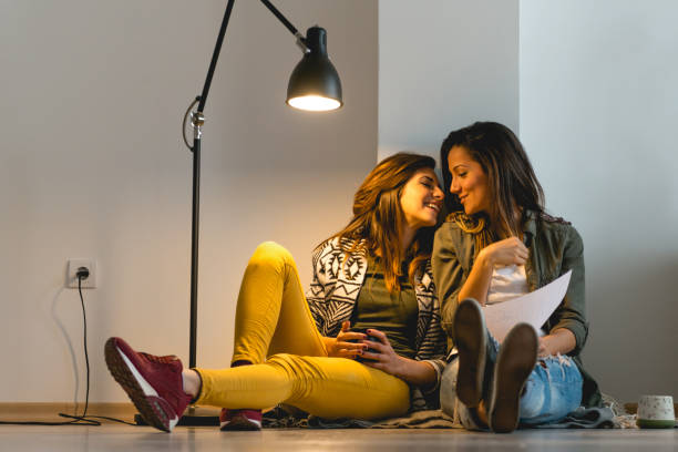 Lesbian couple sitting and smiling stock photo