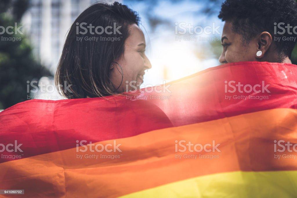 Lesbian Couple with Rainbow Flag stock photo