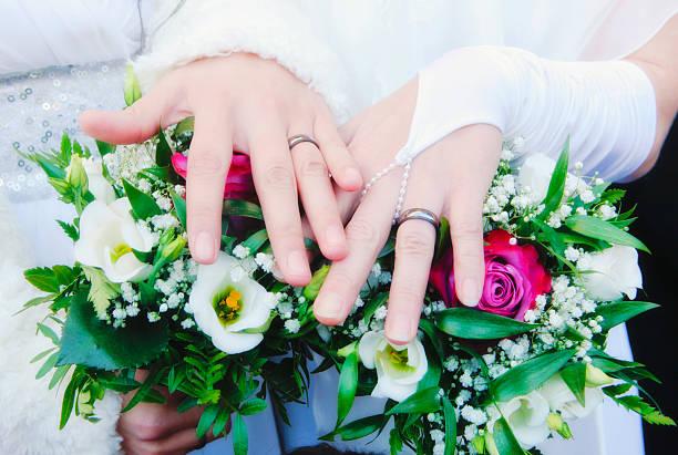 Lesbian Wedding - Newlywed Women Showing their Rings stock photo