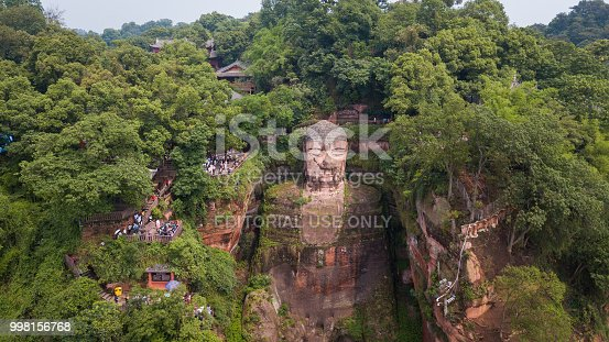 Chengdu, China - 21 May 2018: Tourists visited the Leshan Giant Buddha, it is a 71-metre tall stone statue, built during the Tang Dynasty and Each side of the the cliff is guarded by Buddha's god protector.