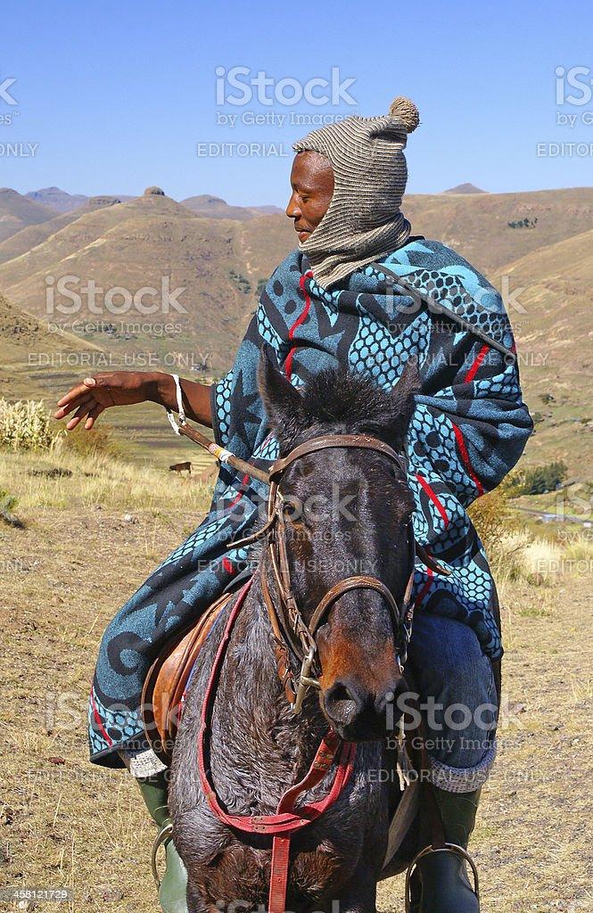 Lesotho man horse riding royalty-free stock photo