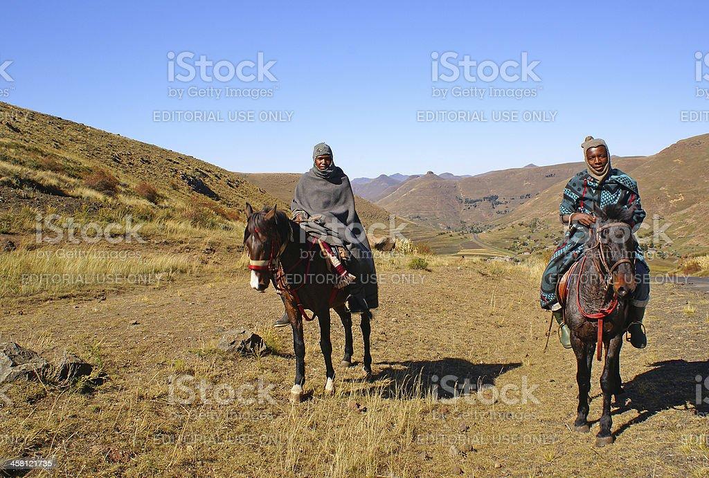 Lesotho men horse riding stock photo