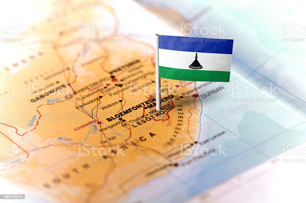 Lesotho pinned on the map with flag stock photo
