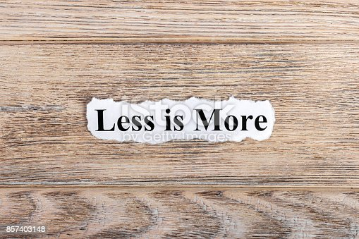 istock less is more text on paper. Word less is more on torn paper. Concept Image 857403148
