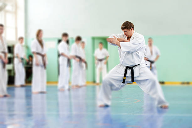 lesson in karate school - karate stock photos and pictures