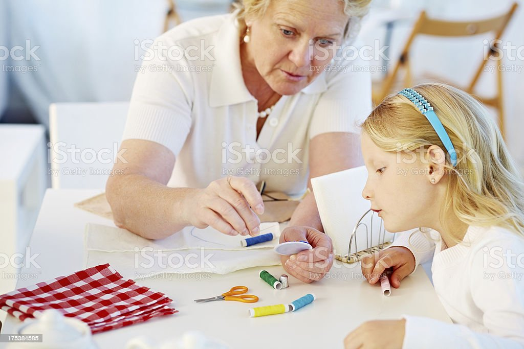 Lesson of handicraft from granny royalty-free stock photo