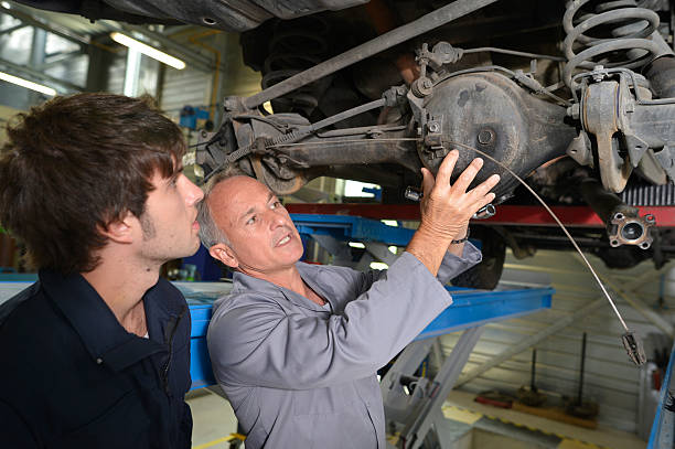 Lesson of mechanics in garage stock photo