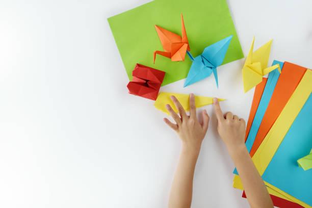 leçon de l'origami - origami photos et images de collection