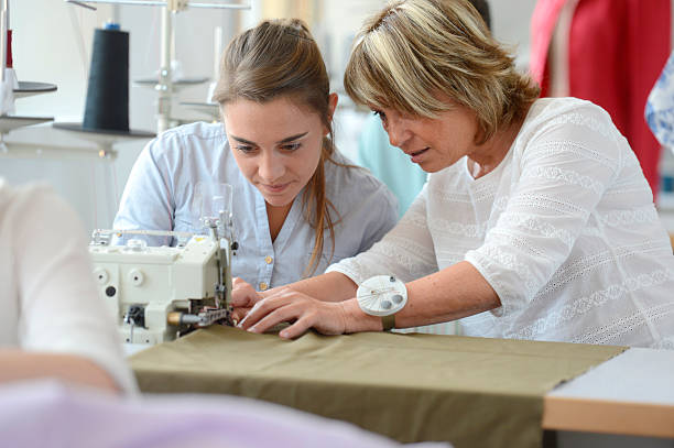 Lesson with sewing machine stock photo