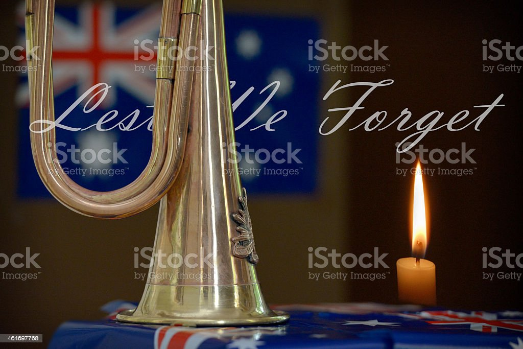 Lest we forget. Bugle, Australian flag and a burning candle stock photo