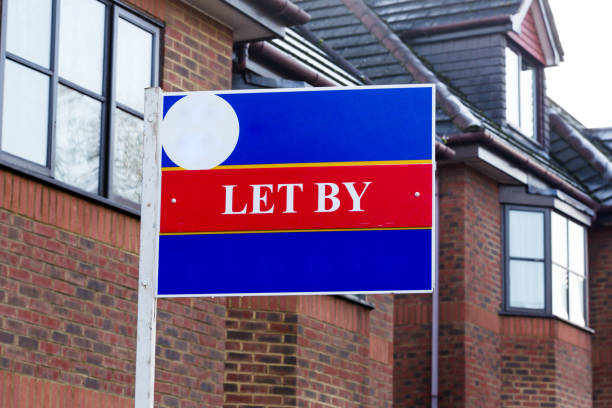 Let by estate agency sign at homes for rent stock photo