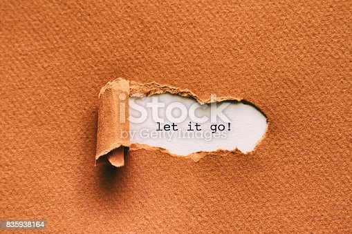 Let it go written under torn paper.