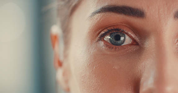 Portrait of a young woman's eyes as she cries