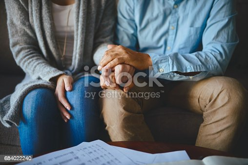 Closeup shot of a couple holding hands in comfort