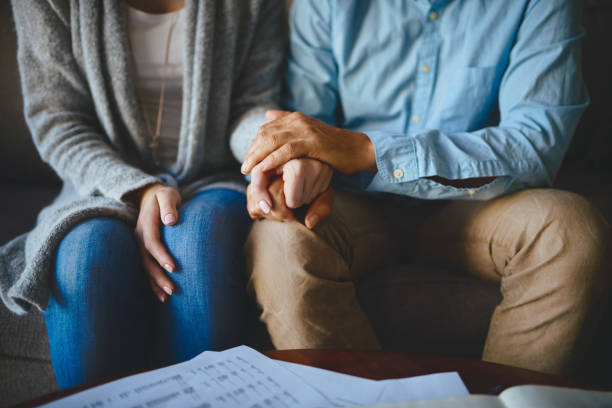 Let love be your greatest source of support Closeup shot of a couple holding hands in comfort husband stock pictures, royalty-free photos & images