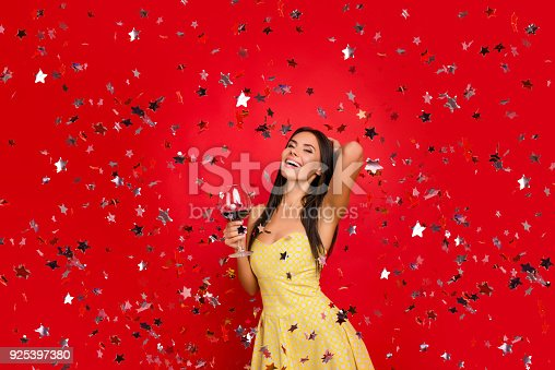 istock Let me be myself! Portrait of beautiful luxurious attractive posh chic rich excited cheerful dreamy birthday-girl savoring expensive wine wearing dotted dress with naked shoulders confetti rain 925397380