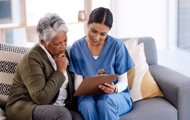 Let me help you make sense of this... Shot of a young nurse going through paperwork with a senior woman medicare stock pictures, royalty-free photos & images