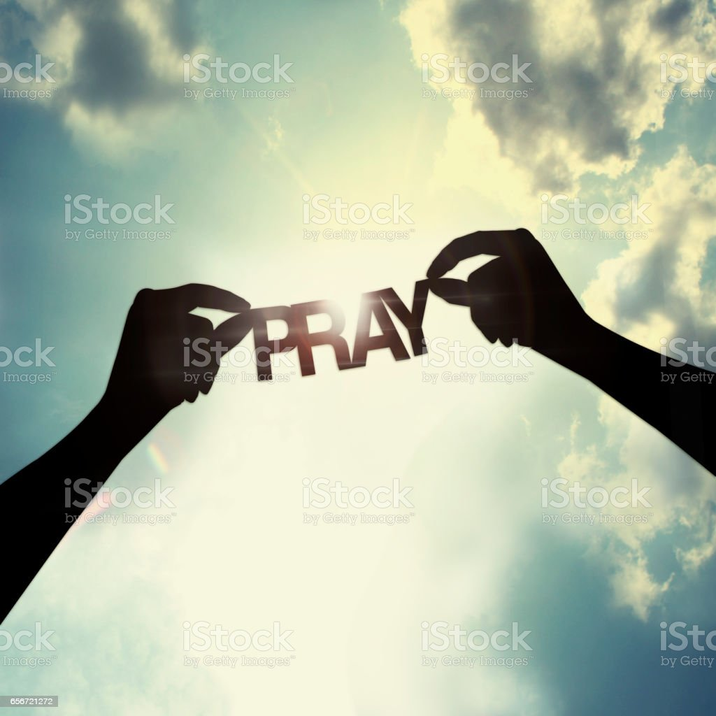 let pray together stock photo