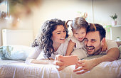 istock Let take a photo of our happy family. 923626146