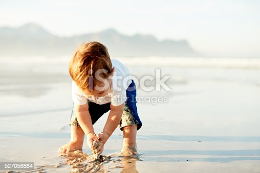 Shot of a little boy playing on the beach
