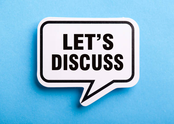 Let Us Discuss Speech Bubble Isolated On Blue Background stock photo
